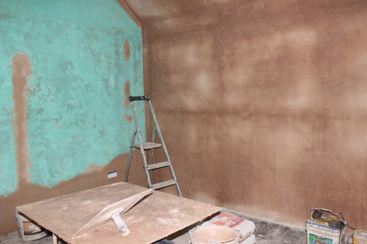 Freshly insulated and plastered walls in the main bedroom.